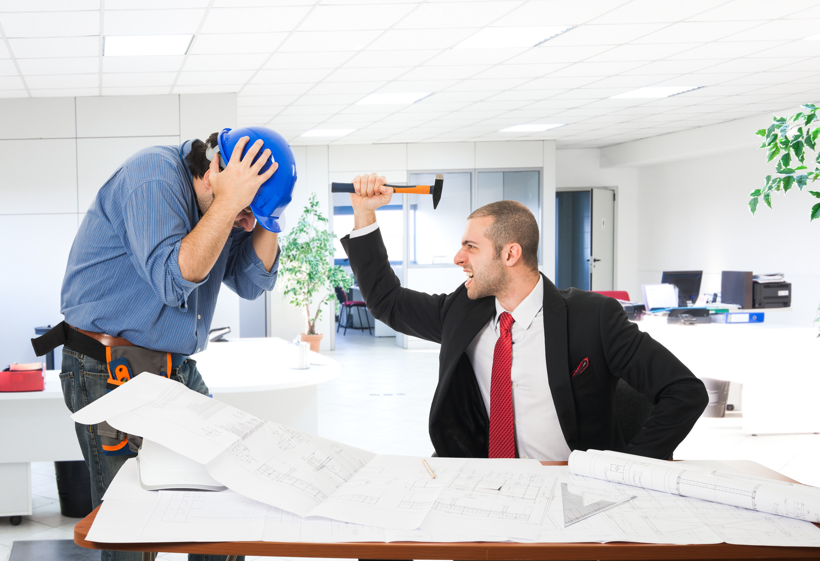 Funny portrait of an angry boss attacking a worker