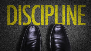 Top View of Business Shoes on the floor with the text: Discipline