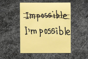 impossible - I am possible concept handwritten on yellow paper note